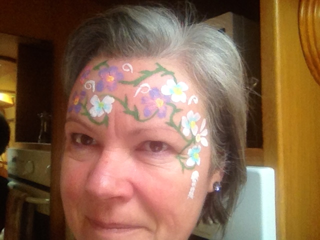 Practicing a spot of face painting in readiness ...