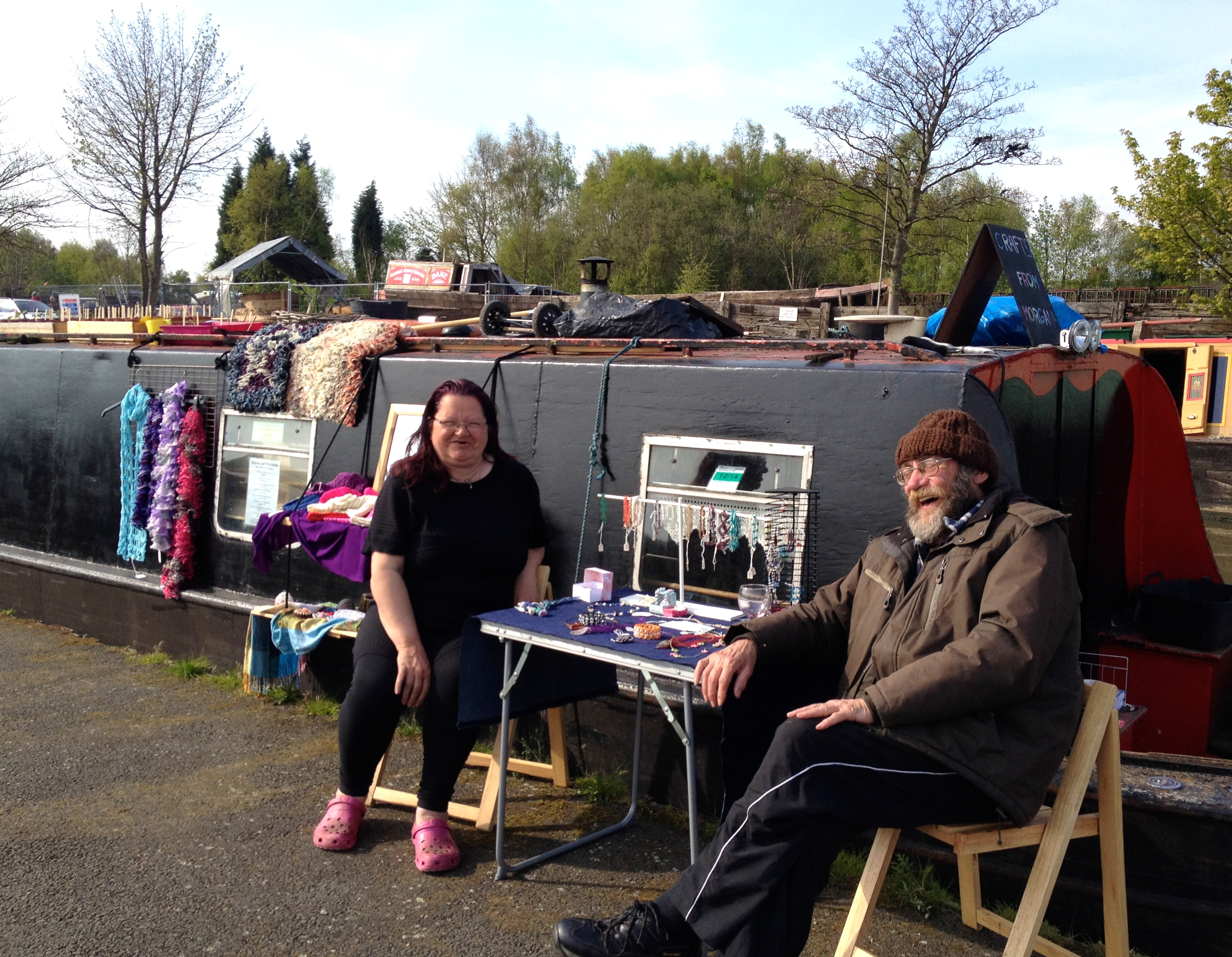"""Lesley and Ray 'Morgana"""" with hand-made jewelry, head bands, hats, and scarves"""