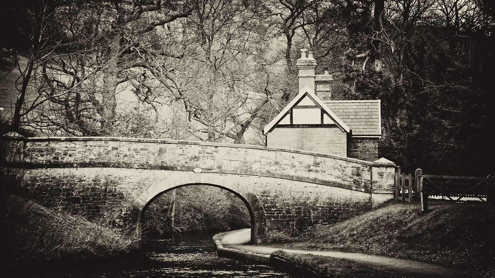Black and white bridge and house