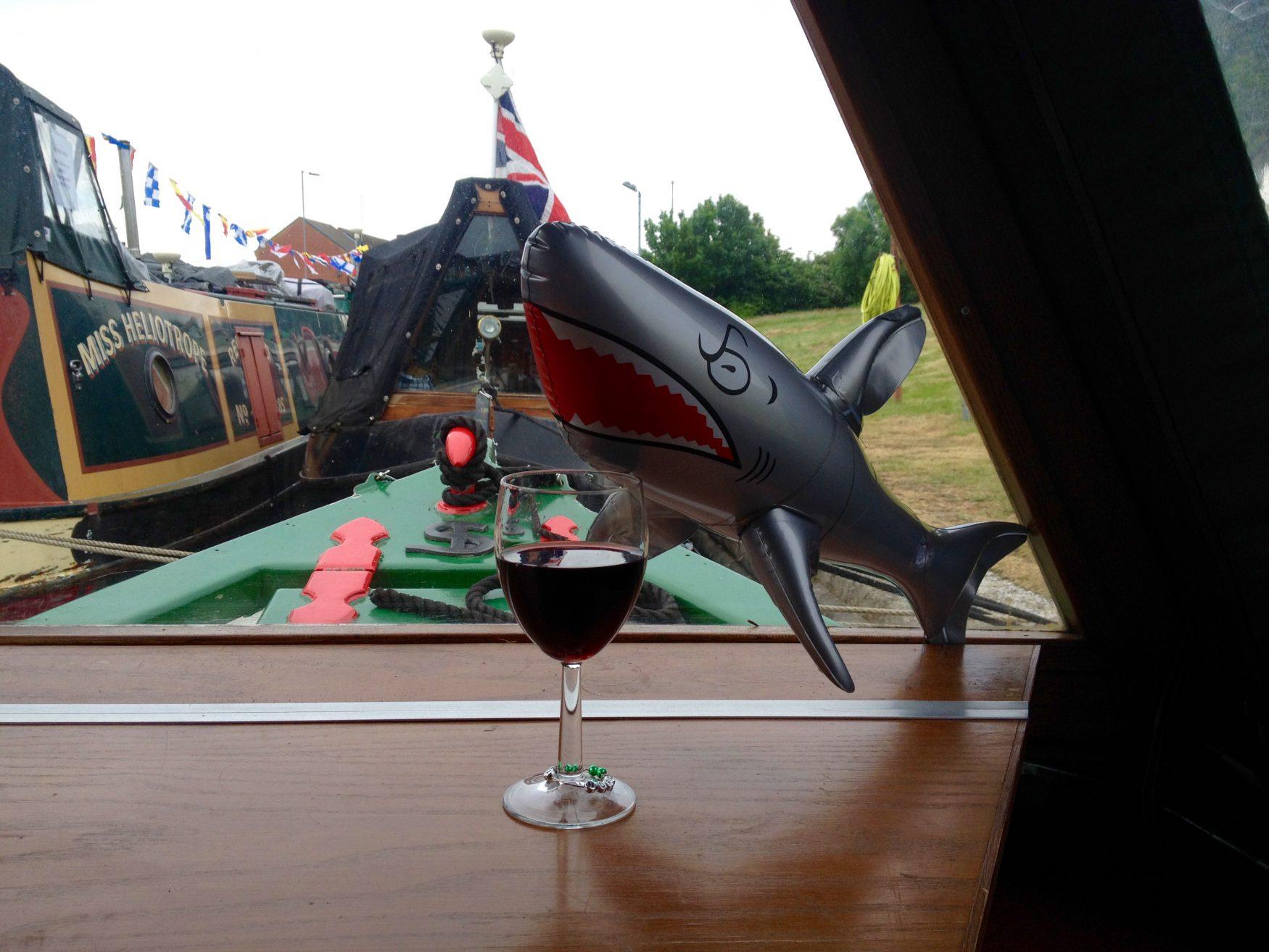Sharky Mc Shark enjoying a red wine on The Home Brew Boat