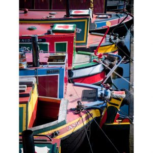 Colourful boats in Gas Street Basin on the Birmingham Canal Navigation