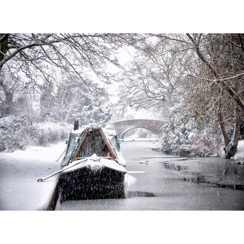 Snowy narrowboat scene on the Coventry Canal at Hopwas